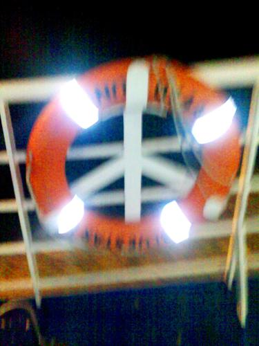 Cartoon: Peace symbol or a life jacket? (medium) by Kostis tagged sea,peace,symbol,life,jacket,ship,wind,salt